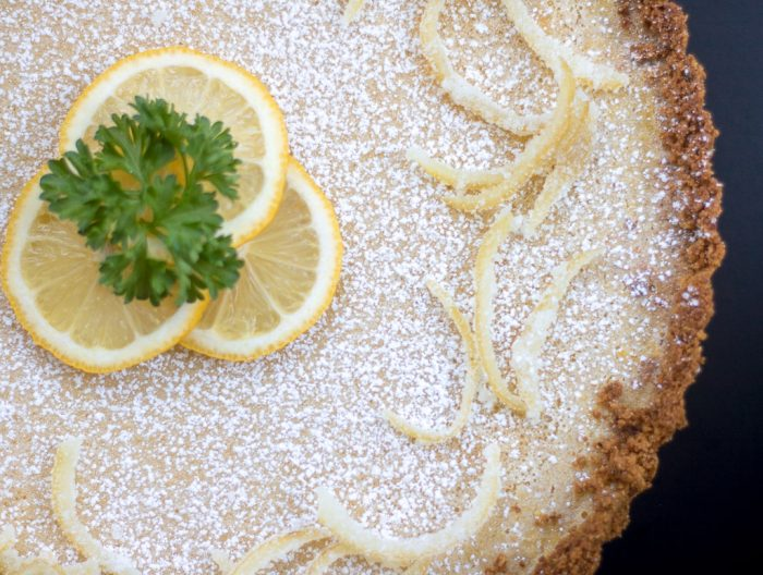 creamy lemon tart with pistachio cardamom crust from above