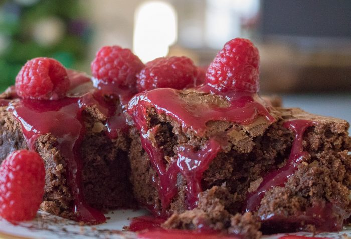 Stack of brownies c raspberry sauce