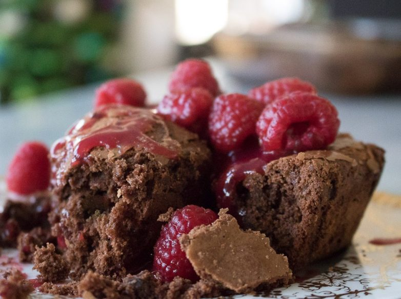 Stack of brownies with fresh raspberry sauce