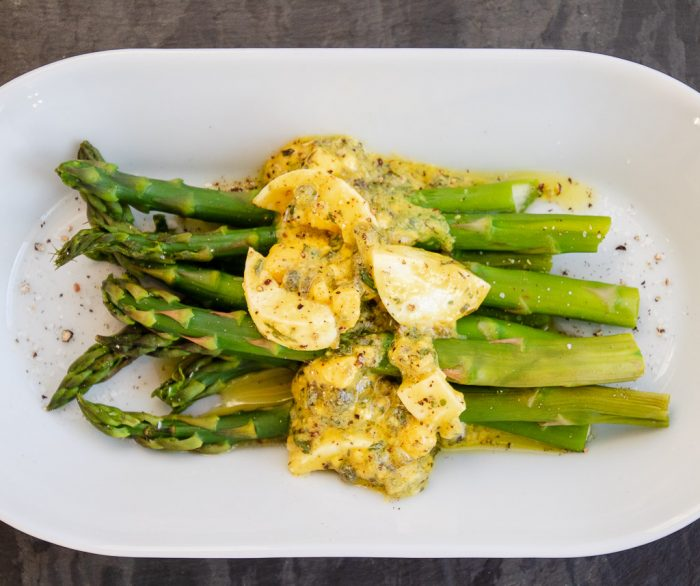 Gribriche sauce on steamed Asparagus from above