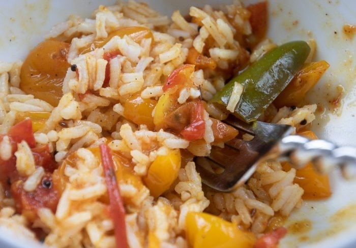 cooked tomato chutney with rice