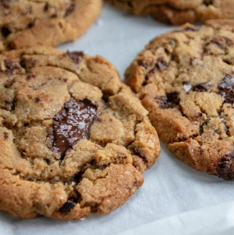 Giant Chocolate Chip cookies with cocoa nibs and Kosher salt