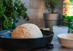 Unbaked Irish Soda Bread in a cast-iron skillet
